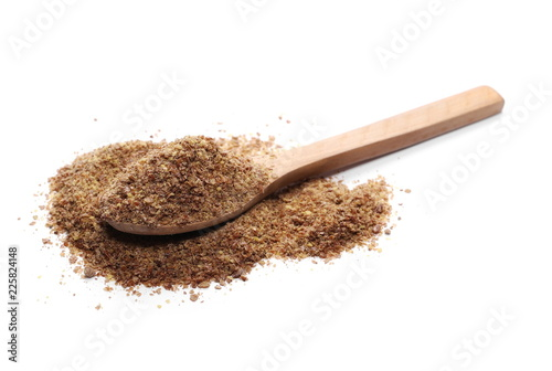 Ground, crushed, milled flaxseed, linseed in wooden spoon isolated on white background