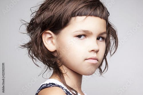 Portrait Of A Girl With A Stylish Hairstyle With A Short Bangs Kaufen Sie Dieses Foto Und Finden Sie Ahnliche Bilder Auf Adobe Stock Adobe Stock