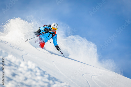 Valokuva  Male freeride skier in the mountains off-piste