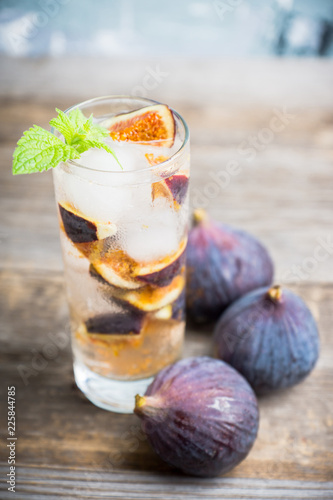 Figs mojito cocktail on the wooden background. Selective focus. Shallow depth of field.