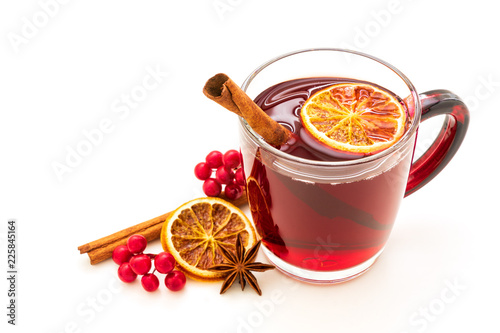 Hot red mulled wine isolated on white background with christmas spices, orange slice, anise and cinnamon sticks