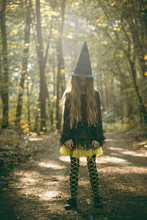 Scary And Spooky Girl In Halloween Costume Outdoors