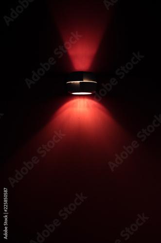 Foto op Canvas Licht, schaduw Single spotlight with a red light beam.