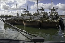 Discarded Military Ship Moored At The Harbor