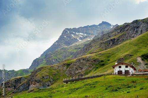 Fotografia  Alpine landscape with htipical house in Aosta Valley, Italy