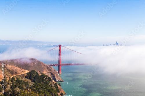 Fotobehang Amerikaanse Plekken Golden Gate bridge surrounded by fog