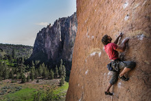 Man Rock Climbing, Smith Rock State Park, Oregon, USA