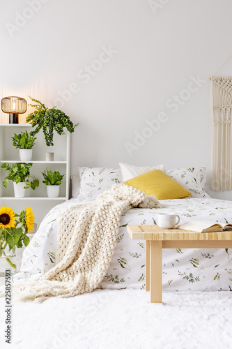 Sunny Spring Bedroom Interior With Green Plants Beside A Bed Dressed In Eco Cotton Linen Yellow Accents Empty White Background Wall Real Photo Buy This Stock Photo And Explore Similar Images