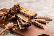 Mixed Gluten Free Granola Cereal Energy Bar With Dried Fruit & Various Nuts, Gray Concrete Background. Healthy Vegan Super Food, Fitness Dieting Snack For Sporty Lifestyle. Top View, Copy Space.