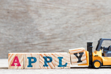 Toy Forklift Hold Letter Block Y To Complete Word Apply On Wood Background