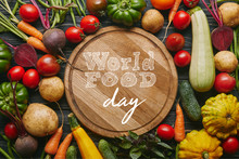"""Variety Of Colorful Vegetables By Cutting Board With """"world Food Day"""" Lettering"""