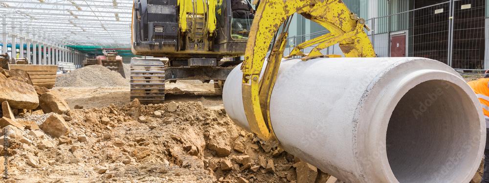 Fototapeta construction site excavator with a concrete pipe