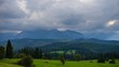 Time lapse shot of sun rays over mountain landscape. Beautiful summer landscape in High Tatras mountains. Sun rays over hills and valley.