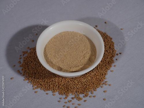 Fenugreek seeds on a wooden Background, Methi Dana and Powder on
