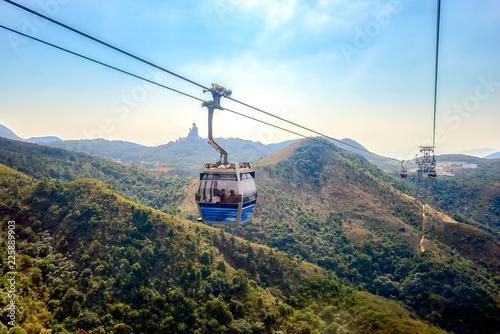 gong Ping cable car with Tian Tan big buddha statue in Lantau Island, Hong Kong China Canvas Print