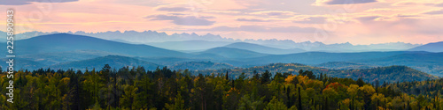 Fotografía Wide angle panorama autumn forest,misty hills mountain tops in pink dawn