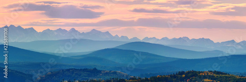 Poster Panoramafoto s Wide angle panorama autumn forest,misty hills mountain tops in pink dawn
