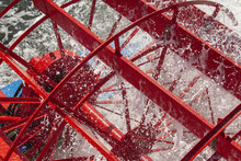 Close Up Of A Red Paddle Wheel Lite Up By The Sun