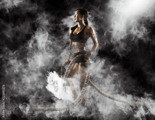 Fotografie, Obraz  Woman working out with battle ropes