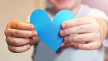 The Child Holds The Paper Blue Heart