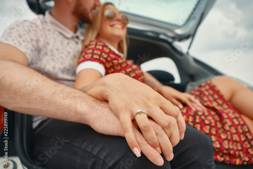 Obraz na plátně  Close up of engaged couple holding hands with diamond ring