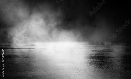 Wall Murals Smoke Background of an empty dark street, wet asphalt. Spotlight, smoke, fog
