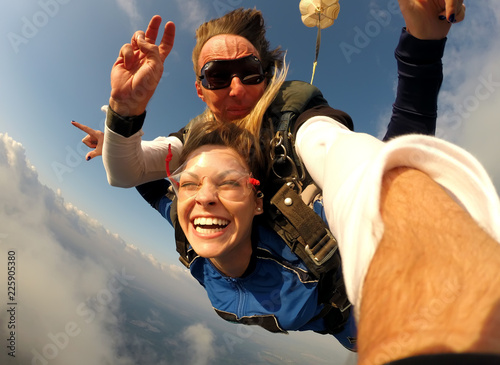 Fotobehang Luchtsport Selfie tandem skydiving with pretty woman