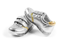 Flat Lay. The Silver Children's Sports Shoes Isolated On A White Background
