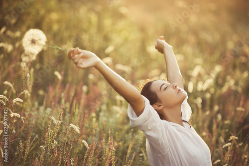 Free Happy Woman Enjoying Nature Beauty Girl Outdoor Freedom Concept Beauty Girl Against Sunny Flowers Field Sunbeams Enjoyment Buy This Stock Photo And Explore Similar Images At Adobe Stock Adobe Stock