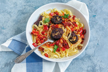Fork In A Plate With Italian Pasta And Blood Sausages.