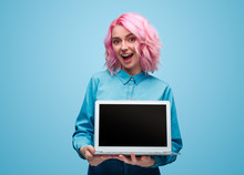 Excited Young Woman Showing Laptop