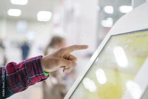 close up person using touch screen panel in post office to recieve a package f Wallpaper Mural