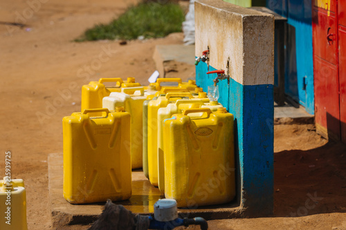 Fotografering Water cans in Uganda, Africa