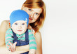 young beauty mother with cute baby, red head happy modern family