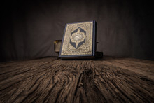 Koran - Holy Book Of Muslims ( Public Item Of All Muslims ) On The Table , Still Life