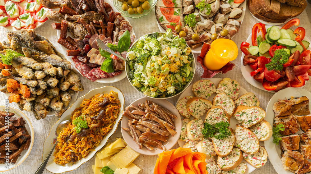 Fototapety, obrazy: Table filled with snacks and traditional eastern European (Lithuanian) food for a feast celebration.