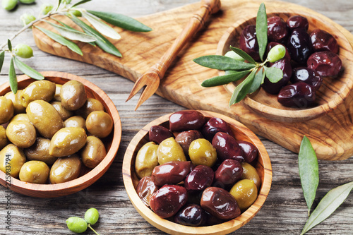 Bowls with different marinated olives. Healthy snack or appetizer.