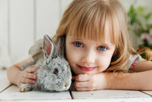 Cute Girl Hugging With Rabbit ...
