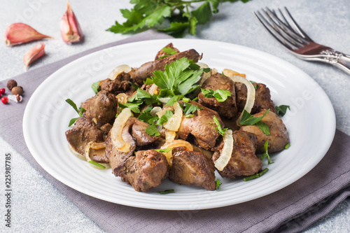 Baked chicken liver with onion on a plate