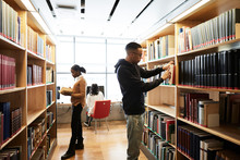 Students Searching Book While ...