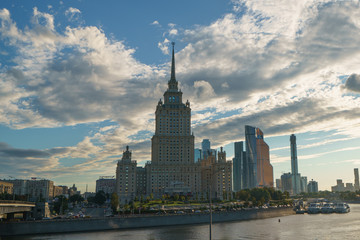 Moscow city image at the sunset. One of the Stalin era houses image (Ukraine hotel) and Moscow City (modern business buildings)