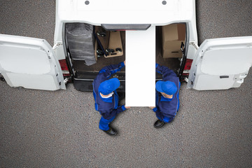 Obraz na Plexi Mover Unloading Furniture From Vehicle