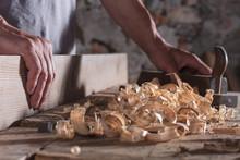 Man Scraping Curled Wood Scrap...
