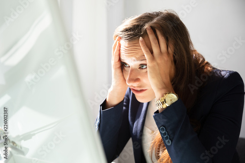 Close-up Of A Stressed Young Businesswoman