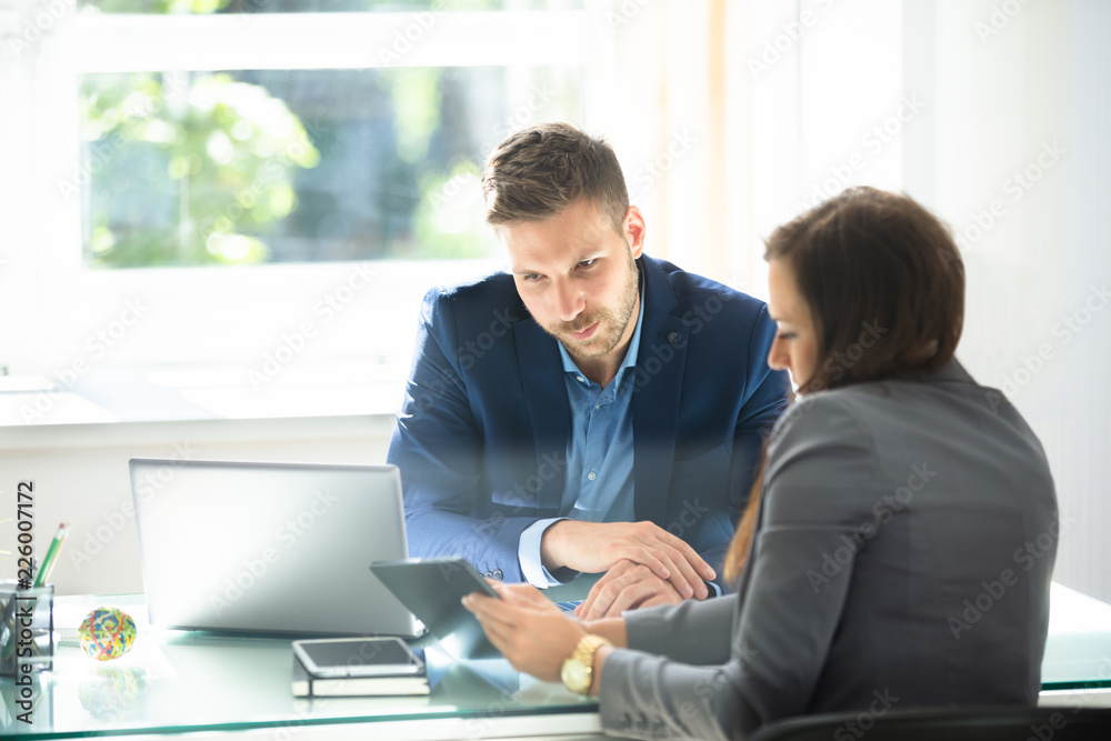 Fototapeta Two Businesspeople Using Digital Tablet