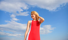 Woman Red Dress Feels Carefree And Free. Definition Of Female Freedom. Satisfied With Single Life. Key To Being Happy. Girl Blonde Lady Smiling Enjoy Freedom And Fresh Air Wind Blue Sky Background