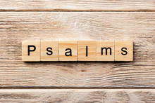 Psalms Word Written On Wood Block. Psalms Text On Table, Concept