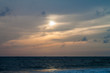 Sun, clouds and a sea