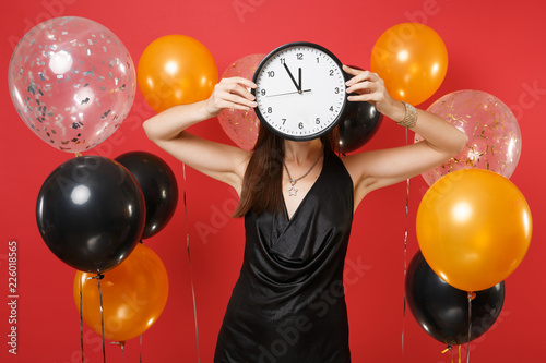Young Woman In Black Dress Covering Face With Round Clock On Bright Red Background Air Balloons Time Is Running