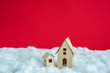 two houses of paper, white snow, red background with copy space, for advertising, close up